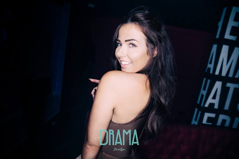cute girl posing at drama nightclub