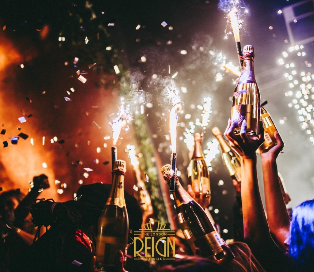 party at reign showclub with champagne